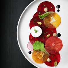 Beet Carpaccio Salad with orange, goat cheese and balsamic vinegar reduction