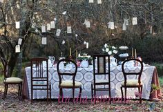 Alice in Wonderland Wedding, like the mis-matched chairs. Need something else hanging over head.
