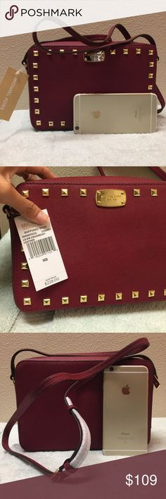 New Michael Kors big leather crossbody camera bag Brand new with tag attached. Never used. Never worn. In a perfect condition. Size is 9.5 x6x2. The color is cherry on the tag. Tag price is $228 . The price is firm. Please don't waste your time bargaining. 100% cow leather. Michael Kors Bags Crossbody Bags