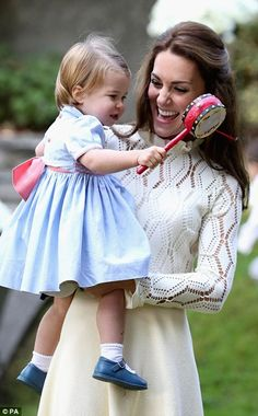 Little Princess Charlotte quickly worked out how to play with the drum, much to her mother Kate's delight