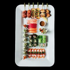SUSHI - appealing display great for a canape tray. However, displayed on lucite tray