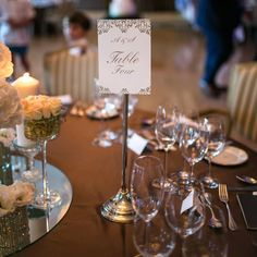 Alexandra selected foil-pressed table numbers from Minted, which matched her wedding invitations.