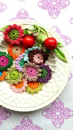 Beautiful crochet flowers in Dutch. Shame ;//