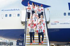 Golden girls! Team GB's women's hockey team pose on the steps of their BA plane after arriving back from Rio yesterday