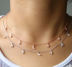 Dainty Chain with dangling suns, stars and moons cz diamond charms. The Celeste Choker is perfect for layering with your everyday jewelry necklaces and choker for a Chic Boho Look. Available in Rose Gold or Silver Plating. Diamond choker, dainty chain delicate charm choker necklaces-chokers, layering. .925 Sterling Silver, Cubic Zirconia Diamonds