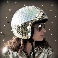 "DIY: Disco Ball Helmet Why make a disco ball. - DIY: Disco Ball Helmet "" Why make a disco ball helmet? Because it's awesome. I've seen disco ball helmets before, but they didn't satisfy the perfectionist in me. No haphazardly glued. Motorcycle Helmet Design, Bicycle Helmet, Scooter Helmet, Motorcycle Babe, Motorcycle License, Bike Helmets, Motorbike Girl, Cycling Helmet, Scooter Girl"