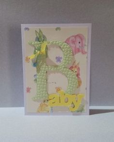 Baby Card with cut-out letters. Pin, ribbon and paper in custom colors available.