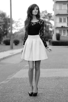 White skater skirt with black long sleeve lace top and black high heels - love this