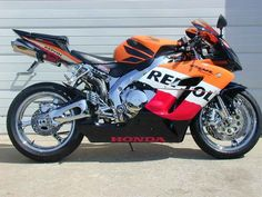 Used 2005 Honda CBR®1000RR Repsol Motorcycles For Sale in North Carolina,NC. BAM! THIS THING IS BAD! This is a ORANGE ,BLACK and BLUE ,REPSOL EDITION 2005 CBR1000RR WITH ONLY 418 MILES!! This bike is ALL CHROME , NOT POLISHED (let me say it again, ALL CHROME)!! FRAME, SWINGARM, TRIPLE TREE, SUBFRAME, WHEELS, FORKS, CARRIERS, PEGS and PEG SETS, CONTROLS and EVERY NUT AND BOLT SEEN WITH THE EYE!! It also has extras that include FULL TITANIUM AKROPOVIC EXHAUST, ORANGE MEMPHIS SHADES WINDSCREEN…