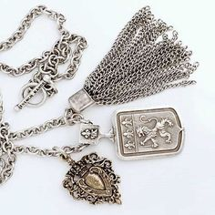 """French Kande 38"""" Antiqued Sterling Silver-Clad Watch Fob, Royale Medallion and Tassel Necklace from Sage Accessoies. The antique silver-clad charm necklace is a bold statement necklace, a great piece that will add an edge to anything you have on."""