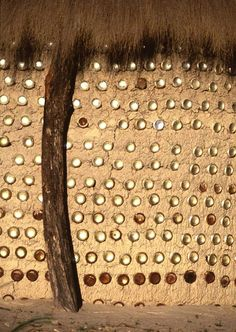 Botswana mud hut with cans by Geoff Spiby on Flickr
