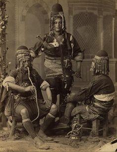 1880 and 1900.  Abdullah frères, photographer. group portrait of three men, one smoking a nargile, possibly irregular cavalryman (bashi-bazouks or basibozuks)