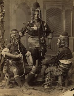 1880 and 1900.  Abdullah frères, photographer. group portrait of three men, one smoking a nargile, possibly irregular cavalryman (bashi-bazouks or basibozuks)