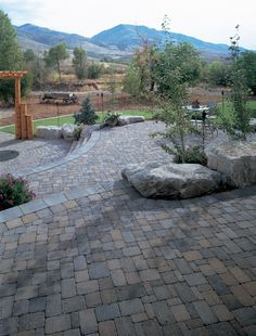 Colours of these pavers blend well, love the different levels and the big gray boulders and wow the setting! Outdoor Landscaping, Outdoor Gardens, Landscaping Ideas, Concrete Paver Patio, Outside Room, Outdoor Living, Outdoor Spaces, Colorado Homes, Backyard Retreat