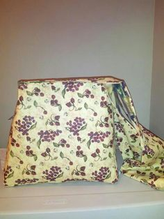 Grape reversible purse with side pockets.