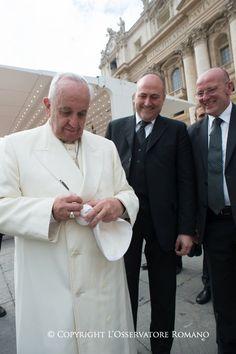Pope Francis autographs a baseball