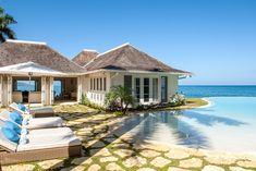 Three acres of seamlessly blended landscape, house, and private beach? Yes, please! With seven bedrooms, two swimming pools (including this dreamy infinity), golf course, and ocean all at your fingertips, this Grecian-inspired oceanfront villa