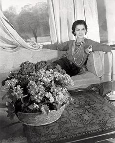 Coco Chanel in her Ritz apartment - wearing her signature cuff bracelets