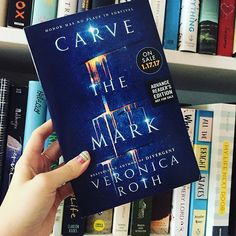 "I was so excited to receive this beauty in the mail! Everyone here at OwlCrate Headquarters can't wait to read it. In case you didn't know, CARVE THE MARK is the upcoming release from the author who wrote the Divergent series, Veronica Roth. However, her new book sounds very different from Divergent. Here's a brief synopsis: ""On a planet where violence and vengeance rule, in a galaxy where some are favored by fate, everyone develops a currentgift, a unique power meant to shape the future…"