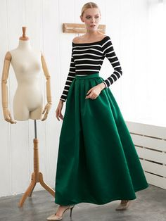 A dark green maxi skirt to change up your winter jeans uniform.