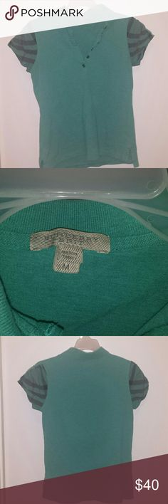 Women's Burberry Brit polo style shirt. This women's top is like like a dark seafoam green. It's short sleeves is a plaid Burberry print. It buttons up in the top front (cleavage area) and there are no missing buttons. It has some fading, but it was originally a faded look anyways. It feels good on and has somw stretch to it. 98% cotton and 2% elastane. Smoke free and pet free home.  And yes this is authentic just as is all things for sale in my closet. Burberry Tops