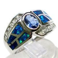 WELCOME TO CINDERELLA'S REVENGE  PLEASE READ EVERYTHING BELOW CAREFULLY. THANKS!  STUNNING TANZANITE, BLUE OPAL & WHITE CZ RING SET IN 925 STERLING SILVER. THE NATURE OF THE WAY THESE STONES ARE SET MAY MAKE IT HARD TO SIZE, BUT ASK YOUR LOCAL JEWEL...