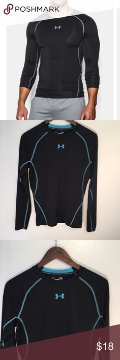 Under Armour Compression Shirt Under Armour Heat Gear Compression Shirt. In excellent condition with no flaws! This shirt is ultra-tight and fitted like a second skin. Shirt for sale is black with light blue stitching. Under Armour Shirts