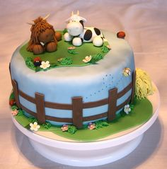 Cow Cake Inspired by Loraines fantastic designs and figures I wanted to improve my modeling skills by making these two lovely cows....