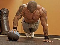 Alternating hand, plyometric push-ups on a medicine ball... very effective...