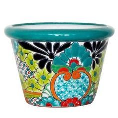 These large Talavera planters feature wonderfully intricate floral patterns that will look great with your plants, indoors or out! The ceramic of these Talavera planters is hand-painted in Dolores Hidalgo, Mexico, and embodies all the classic charm of Mexican Talavera. Available in several shapes and sizes, all Talavera planters also feature a convenient drain hole. Let the bright colors and your plants breathe life back into your home decor!