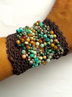 Coffy Crochet - Earthy and rustic, one of a kind, free form crochet lace cuff in a rich collection of Czech fire polished glass seed beads and semi precious beads