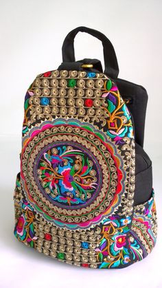 An Ethnic Style Backpack with Traditional Hmong Fabric. This bag exhibits brilliant colours with unique embroidery patterns  FEATURES: Vibrant embroidered up cycled patterns Comfort & Lightweight A fully lined zippered compartment with exterior pockets Durable fashion design with a lasting impression  MEASUREMENTS:  Length (cm) - 33 Width (cm) - 15 Height (cm) - 34  WEIGHT - 480 grams    ( FREE SHIPPING WORLDWIDE ) : Goods will be sent by (*Registered International Airmail) Please allow 8...