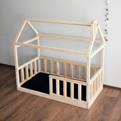 Wooden house bed frame will make your kids room more attractive. It can be used as a bed for baby just after a crib or already a toddler bed. House bed can be made directly on floor, so you will not have fear that your baby can roll out, or you can order it upper with slats for mattress.