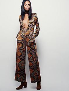 New Romantics Anastasia Playsuit | Slinky jumpsuit with a retro-inspired print and deep V-neckline. Features long sleeves, metal stud details and hip pockets.