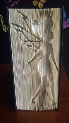 Tinkerbell Cut and Fold Book Folding Pattern for a a great personalized gift idea and will be something different from high street bought products.