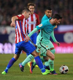 Lionel Messi of FC Barcelona slips past Juanfran of Atletico Madrid during  the Copa del Rey 3bbc24c43