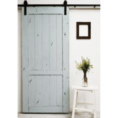 The Country Vintage Barn Door features a lightly distressed finish on a classic barn door design.  This style is versatile, and fits well in almost any setting.