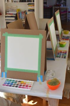 quick and easy way to make your own table easel with cardboard. just needs something to catch pain drips. #startingyourowndaycare