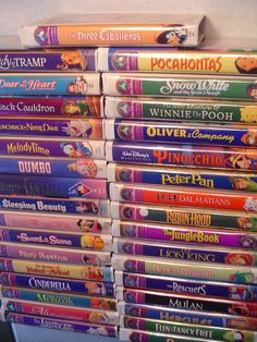 Perfectly stacking your Disney VHS tapes into a magnificent tower. | 21 Little Satisfying Things Every '90s Kid Did