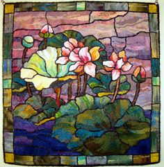 Water Lilly designed and hooked by Carla Fortney  Stained Glass effect......definitely an idea!