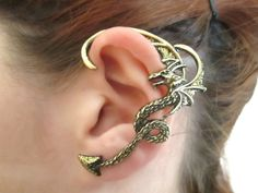 This cute dragon ear cuff is hand painted with black color and gold glitter in wings and at the end of the tail. Item is originally antique gold