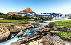 Though Glacier National Park is normally chilly in the spring, it is the best ti... - Shutterstock