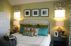 Love the green walls and crisp white accents in the bedroom.