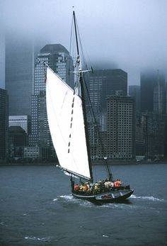 NYC. Bluescape with crowded sail ship