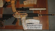 Gold and silver-plated weapons seized in Mexico in May, 2010. Attorney General of Mexico photo