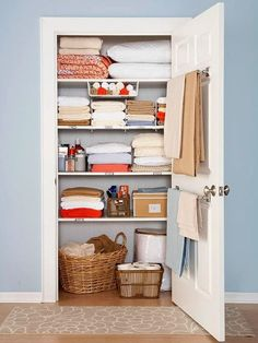 """still love this linen closet.just wish my linen """"closet"""" was an actual closet with one door and not 3 separate cabinets.Use a towel rod on the inside of the linen closet for holding blankets. Linen Closet Organization, Organization Hacks, Closet Storage, Organizing Ideas, Organising, Bathroom Organization, Bathroom Storage, Smart Storage, Bathroom Towels"""