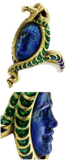 A gold, glass, and enamel Medusa ring by the legendary Art Nouveau jeweler, René Lalique. Circa 1900.