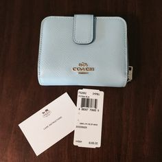 New Light Blue Coach Wallet New coach wallet. Bought to match purse but never used. Coach Bags Wallets