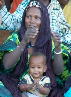 Festival: Woman enjoying music with her child.