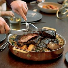 Adam Perry Lang first roasts short ribs, then braises them in beef ...